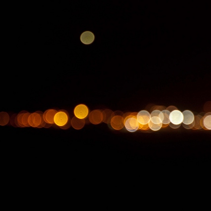 Driving by the Outskirts of a City at Night