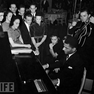 Teddy Wilson plays the piano