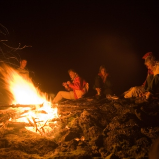 Sitting Around The Fire At A Festival
