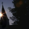 The spin of the earth impaled a silhouette of the sun on the steeple.