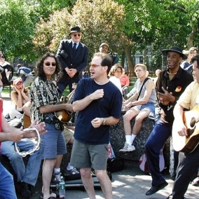 Everyday People Singing a Song on Saturday in the Park