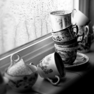 It's raining outside and I have tea