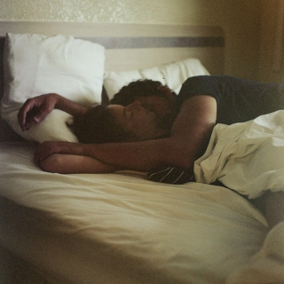 falling asleep in your arms.