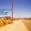 Where Dust and Highway Collide