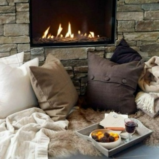 fireplace hot cocoa and sweaters