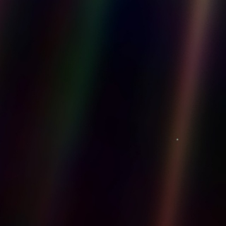 Pale blue dot on a mote of dust