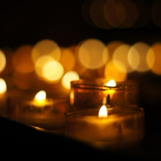 by the candlelight