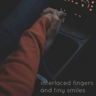 interlaced fingers and tiny smiles