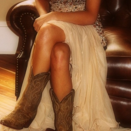 She's country, from the songs she plays to the prayer she prays