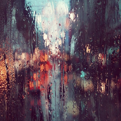 All I can see are blurs of red and yellow through the raindrops..