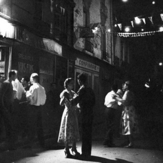 Couples dancing in the streets of Paris.
