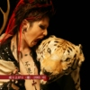 Miyavi yelling at a tiger's head