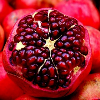 six pomegranate seeds.