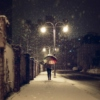 snow under streetlights.