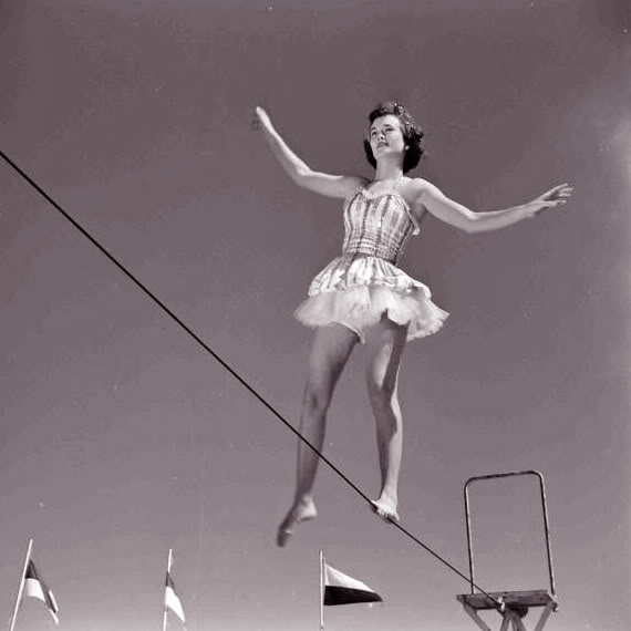 She danced without a net upon the wire.