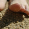 Stick your toes in the sand & listen.