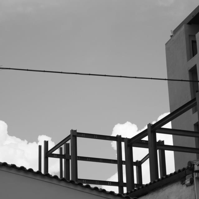 White Clouds and Grey Buildings