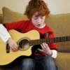 boy meets guitar.