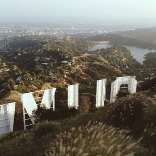 dancing on the edge of the hollywood sign