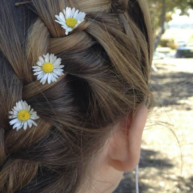 flowers in her hair, smile on her face