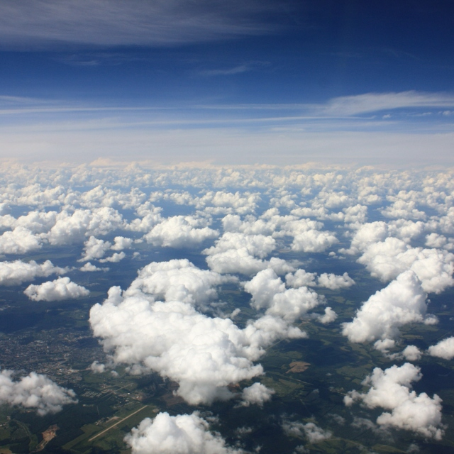 In a plane, miles above the ground