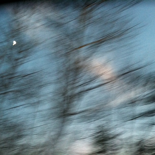 Looking At the Moon Through the Tiny Backseat Window of a Two-door Car