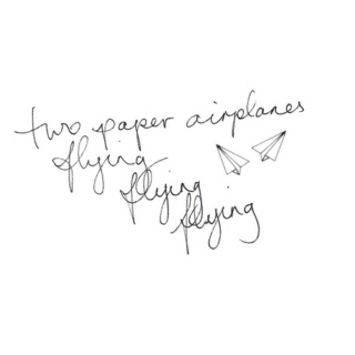 Two Paper Airplanes Flying