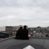 Rooftops and empty beer bottles