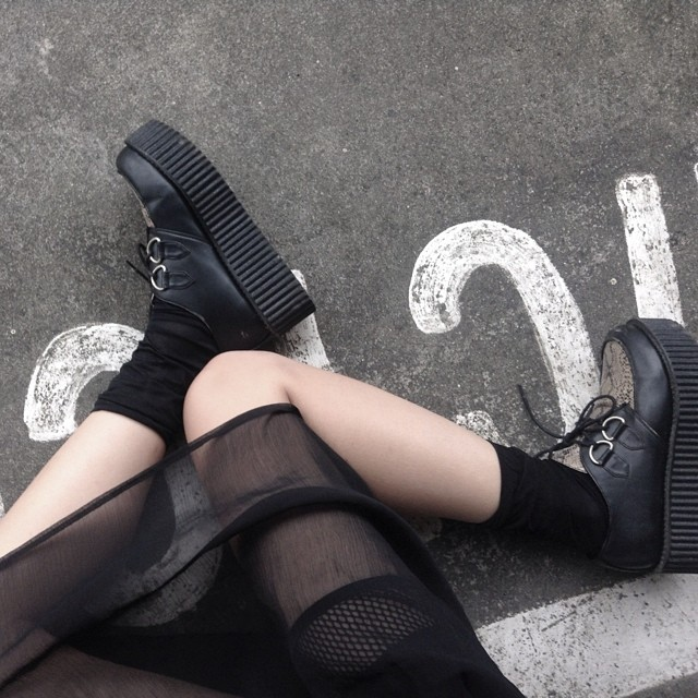 DRESSED IN BLACK FROM HEAD TO TOE