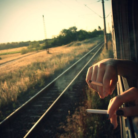I see the world from rusted trains