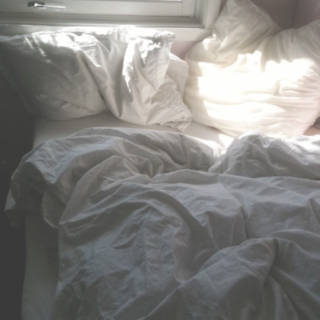 Lying in bed, pretending to be somewhere else.