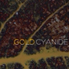 """...the aromatic fumes of gold cyanide."""