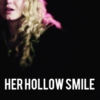 her hollow smile.