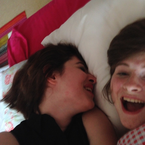 Laughing on the sheets in my room