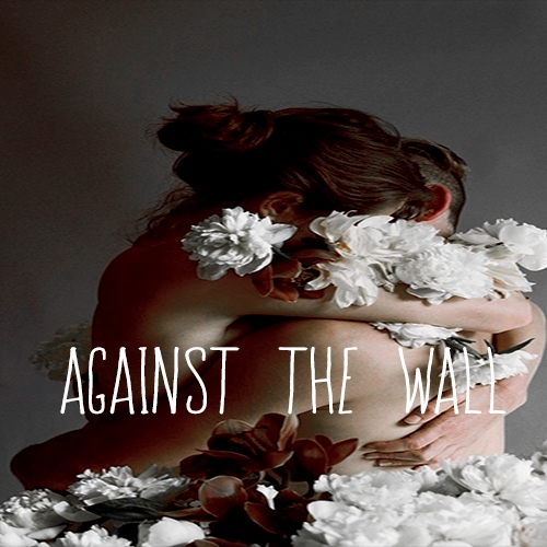 against the wall