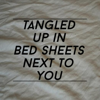 tangled up in bed sheets next to you