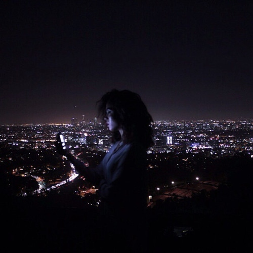 Late night, bright lights, crowded thoughts.