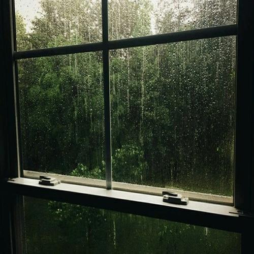 Staring Out The Window Into The Rain