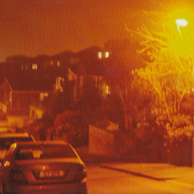 as the street lamps glow