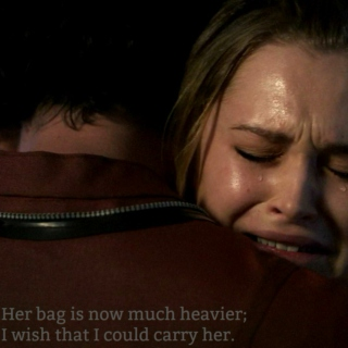 Her bag is now much heavier; I wish that I could carry her.