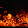 the glass-like tinkling of embers in a slow-burning fire